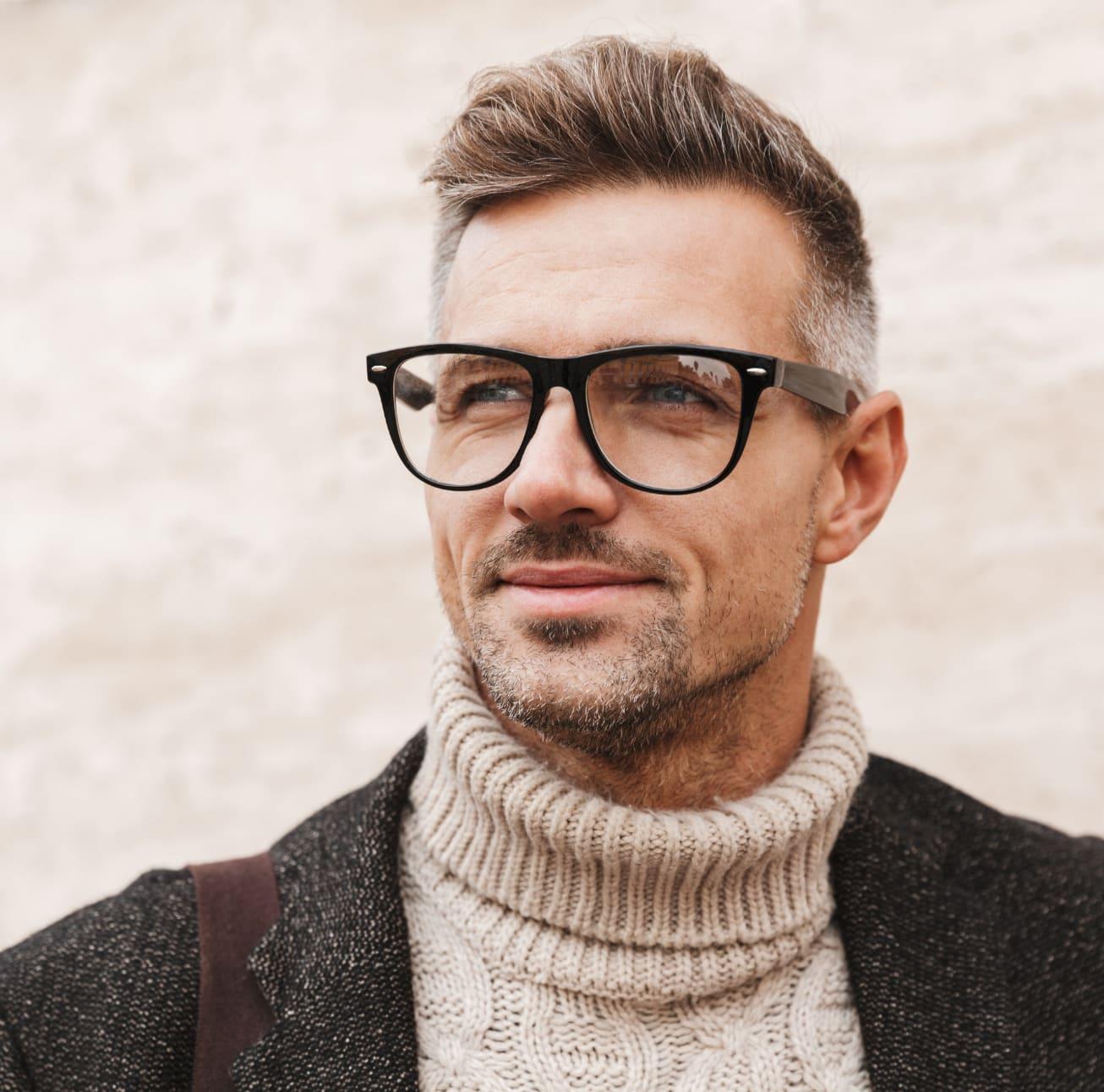 Stylish older man wearing glasses and a turtleneck sweater under a blazer
