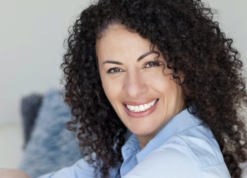 Happy woman after Bellafill treatments