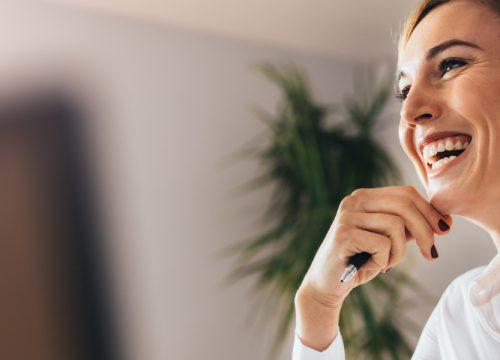 Happy woman at work after successful earlobe repair