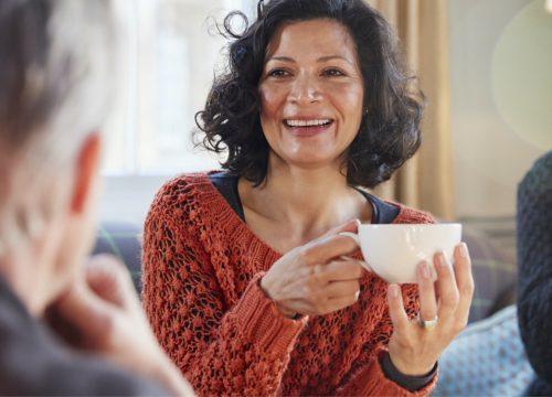 Happy facial resurfacing patient holding a cup of tea