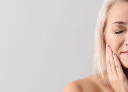 Older woman experiencing facial volume loss