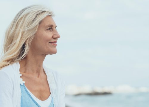 Older woman with a sculpted chin after Kybella treatments