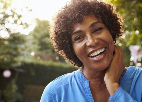Happy middle-aged woman after microdermabrasion treatments