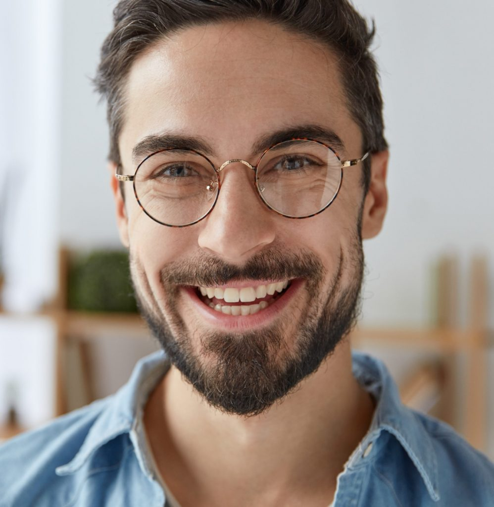 Man with glasses and a goatee