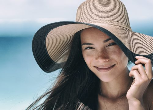 Woman at the beach with sun damage