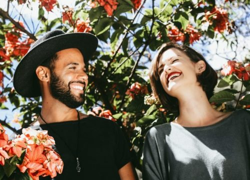 man and women smiling in nature