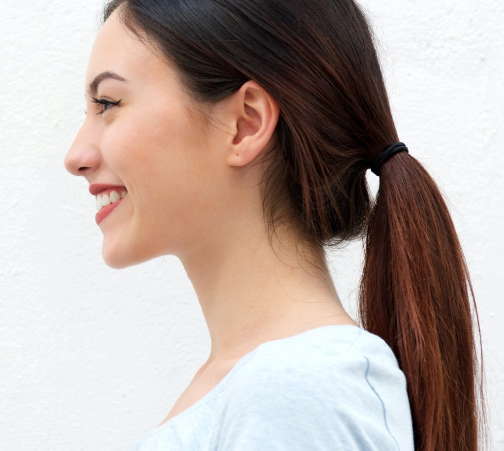 Side view of brunette woman