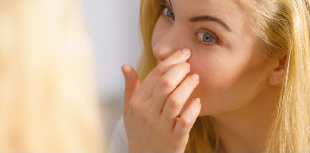 Woman checking for under-eye bags