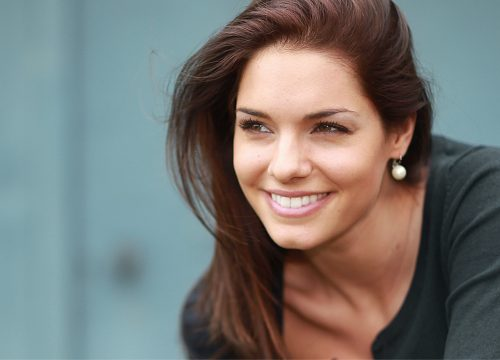 Smiling brunette after a Vivace RF microneedling treatment