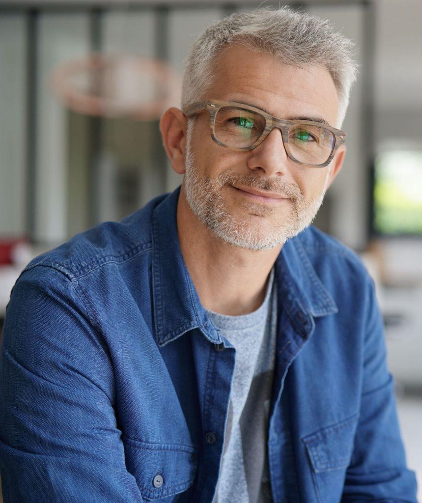 Older man wearing glasses
