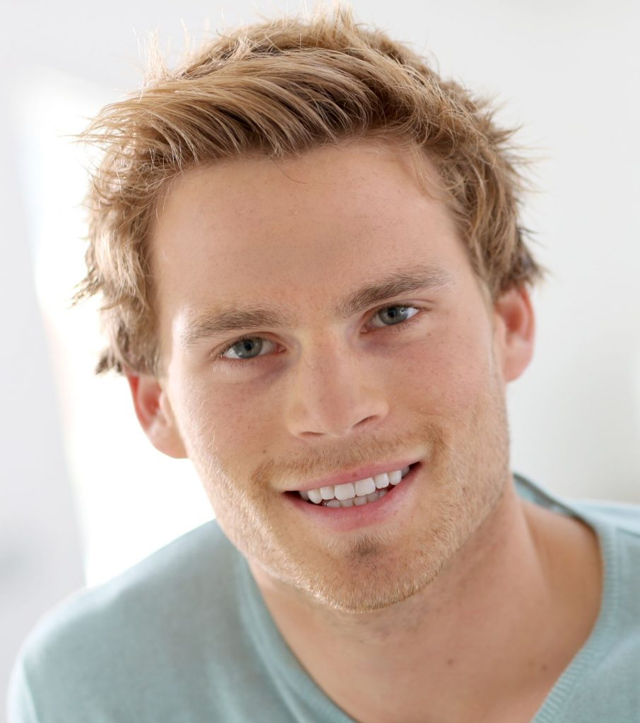 Young man with blonde hair and blue eyes