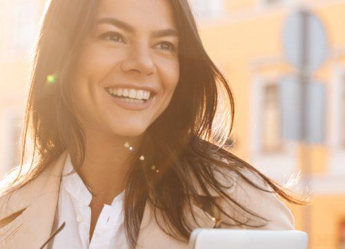 Happy woman outside after microchanneling treatments