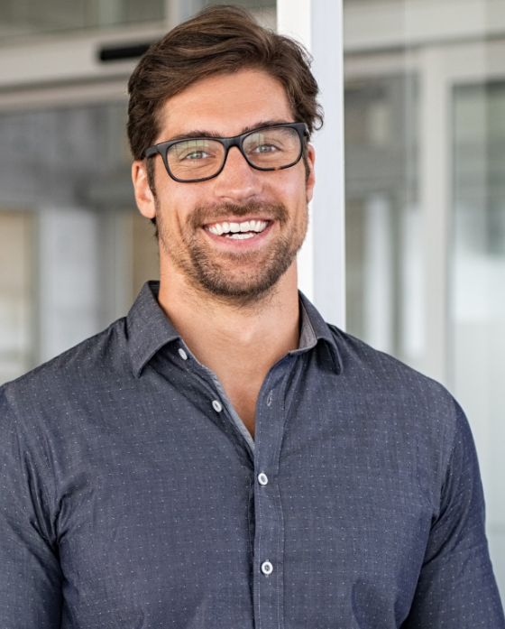 Man with a great chin wearing glasses and smiling